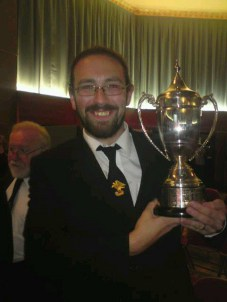 Besses Chairman, Matthew Bailey, holding the trophy !